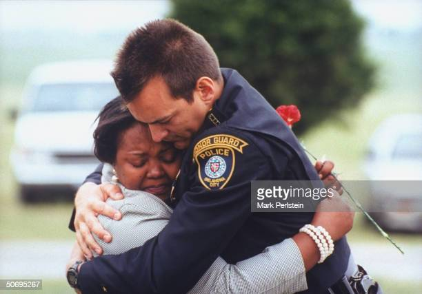 Oklahoma City Police Officer Jim Ramsey embracing coworker Vickie Thomas at funeral for fellow officer Terry Yeakey who committed suicide 4 days...