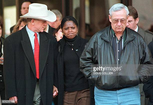 Oklahoma City prosecutor Patrick Ryan consoles Constance Favorite and Roy Sells both of whom lost family members in the Oklahoma City bombing after...