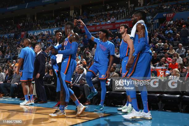 Oklahoma City Thunder bench reacts to play against the Phoenix Suns on December 20, 2019 at Chesapeake Energy Arena in Oklahoma City, Oklahoma. NOTE...