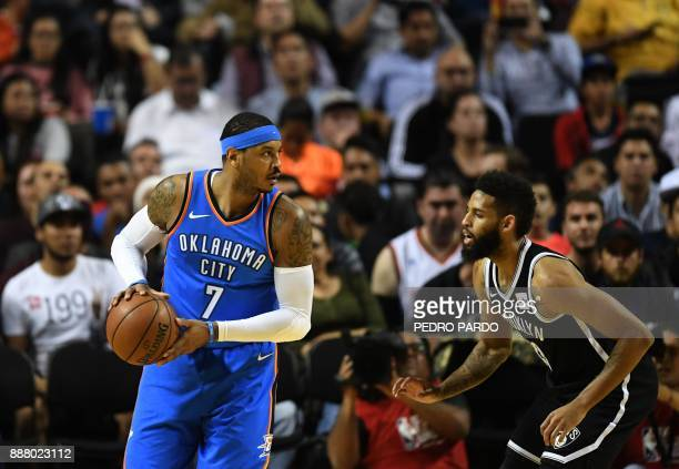 Oklahoma City Thunder Carmelo Anthony vies for the ball with Brooklyn Nets Allen Crabbe during an NBA Global Games match at the Mexico City Arena on...