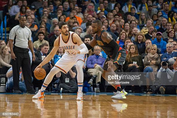 Oklahoma City Thunder Center Enes Kanter making his move towards the basket while Atlanta Hawks Forward Paul Millsap plays defense on December 19 at...