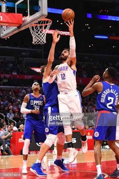 Oklahoma City Thunder Center Steven Adams shoots over Los Angeles Clippers Center Boban Marjanovic during a NBA game between the Oklahoma City...