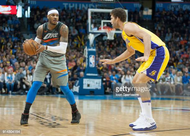 Oklahoma City Thunder Forward Carmelo Anthony looking to pass while Los Angeles Lakers Center Brook Lopez plays defense during an NBA game between...