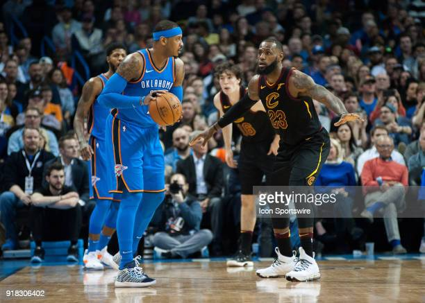 Oklahoma City Thunder Forward Carmelo Anthony looking waiting on the play to develop while Cleveland Cavaliers Forward LeBron James plays defense on...