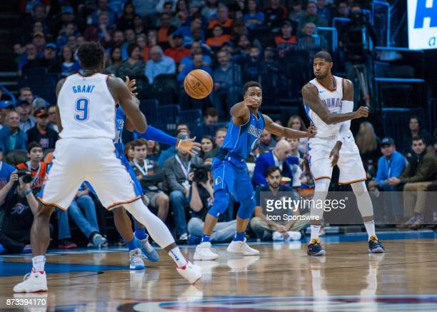 Oklahoma City Thunder Forward Paul George passes the ball to Oklahoma City Thunder Forward Jerami Grant versus the Dallas Mavericks during the...