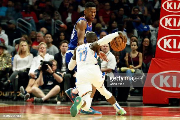 Oklahoma City Thunder guard Dennis Schroder drives past LA Clippers guard Shai GilgeousAlexander during a game on October 19 2018 at the Staples...