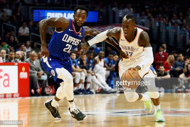 Oklahoma City Thunder guard Dennis Schroder drives past LA Clippers guard Patrick Beverley during a game on October 19 2018 at the Staples Center in...