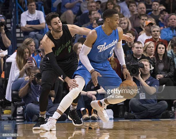 Oklahoma City Thunder guard Russell Westbrook drives around Minnesota Timberwolves guard Ricky Rubio during the second half of a NBA game at the...