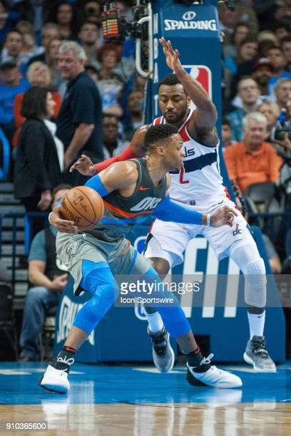Oklahoma City Thunder Guard Russell Westbrook making his move in the paint while Washington Wizards Guard John Wall plays defense during the Oklahoma...