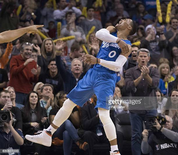 Oklahoma City Thunder guard Russell Westbrook reacts after the Thunder scored against the Minnesota Timberwolves during the second half of a NBA game...