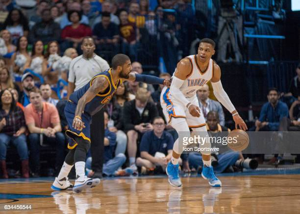 Oklahoma City Thunder Guard Russell Westbrook waiting on a play to develop while Cleveland Cavaliers Guard Kyrie Irving plays defense on February 9...