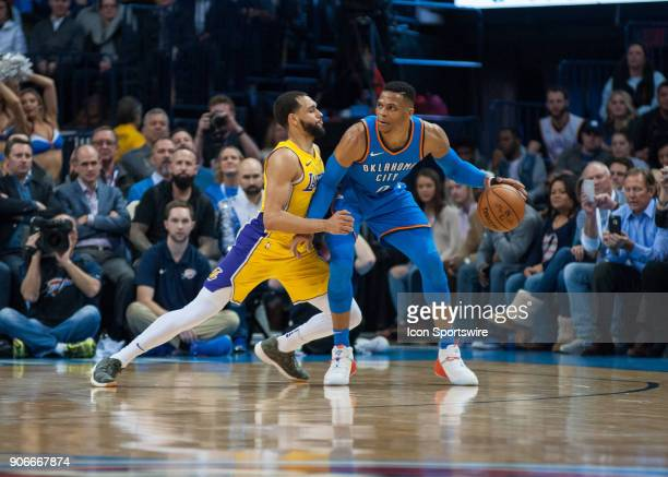 Oklahoma City Thunder Guard Russell Westbrook waiting on play to develop while Los Angeles Lakers Guard Tyler Ennis plays defense during an NBA game...