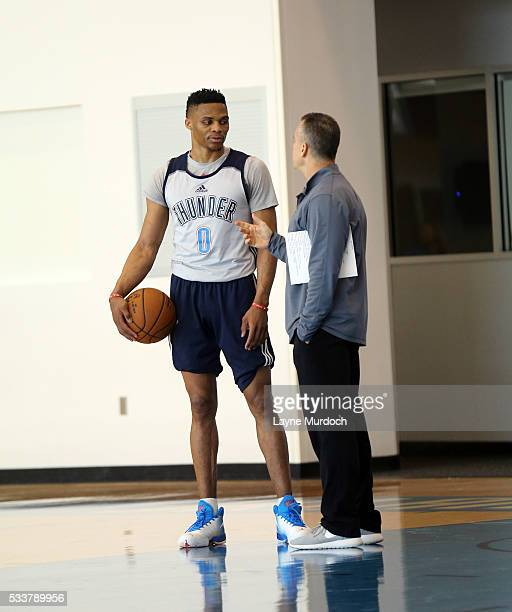 Oklahoma City Thunder head Coach Billy Donovan talks to Russell Westbrook as players and coaches participate in practice on May 23 2016 at the...