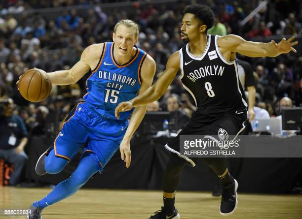 Oklahoma City Thunder Kyle Singler vies the ball with the Brooklyn Nets Spencer Dinwiddie during an NBA Global Games match at the Mexico City Arena...