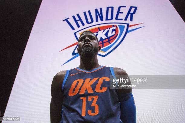Oklahoma City Thunder Paul George wears one of the new league jerseys representing a new partnership between Nike and the NBA on September 15 2017 in...