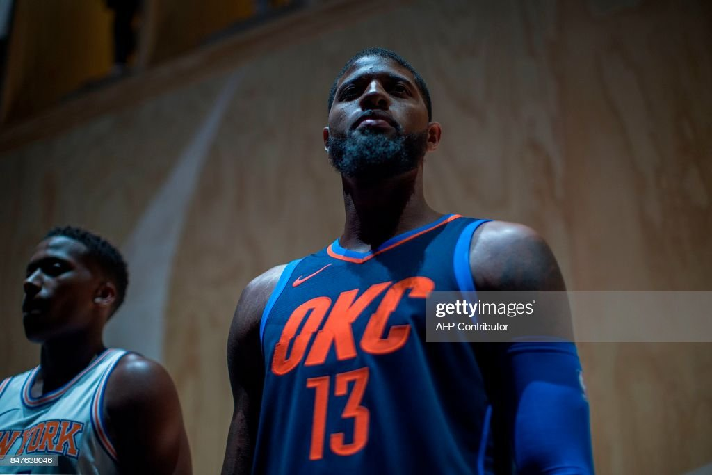 Oklahoma City Thunder Paul George wears one of the new league jerseys representing a new partnership between Nike and the NBA on September 15, 2017 in Los Angeles, California. /
