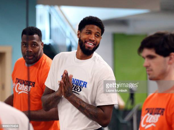 Oklahoma City Thunder player Paul George volunteers with Thunder players coaches and staff on March 15 2018 at the Regional Food Bank of Oklahoma in...