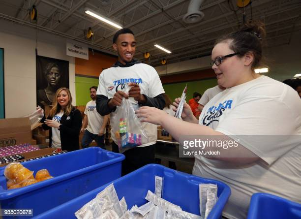 Oklahoma City Thunder player Terrance Ferguson volunteers with Thunder players coaches and staff on March 15 2018 at the Regional Food Bank of...