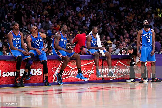 Oklahoma City Thunder players from left Kevin Durant Russell Westbrook Kendrick Perkins Serge Ibaka and James Harden wait to resume action against...
