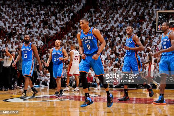 Oklahoma City Thunder players James Harden Derek Fisher Russell Westbrook Kevin Durant and Serge Ibaka walk to the sideline for a timeout in the...