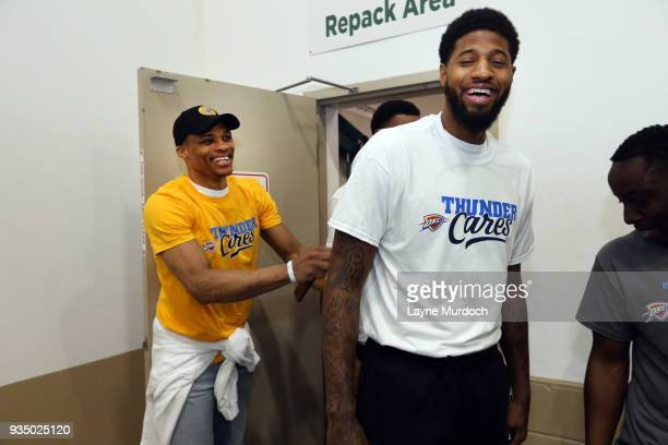 Oklahoma City Thunder players Russell Westbrook and Paul George volunteer with Thunder players coaches and staff on March 15 2018 at the Regional...