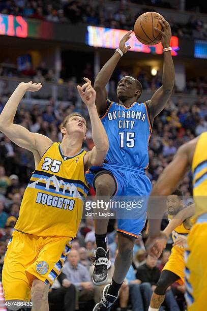 Oklahoma City Thunder point guard Reggie Jackson goes up for a shot on Denver Nuggets center Timofey Mozgov during the fourth quarter December 17...