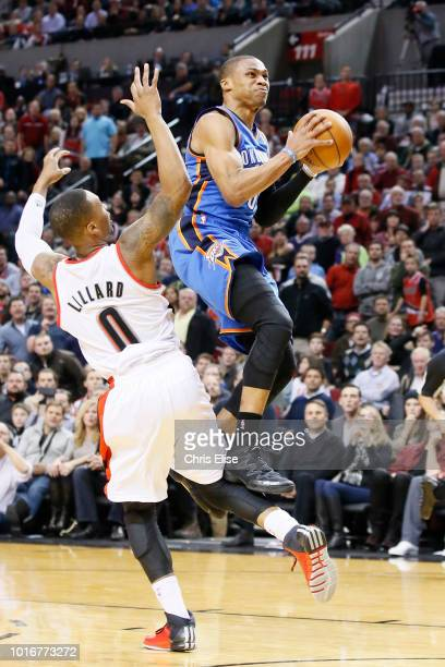 Oklahoma City Thunder point guard Russell Westbrook goes for the layup past Portland Trail Blazers point guard Damian Lillard during the Portland...