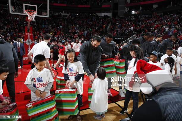 Oklahoma City Thunder present gifts before the game against the Houston Rockets on December 25 2018 at the Toyota Center in Houston Texas NOTE TO...