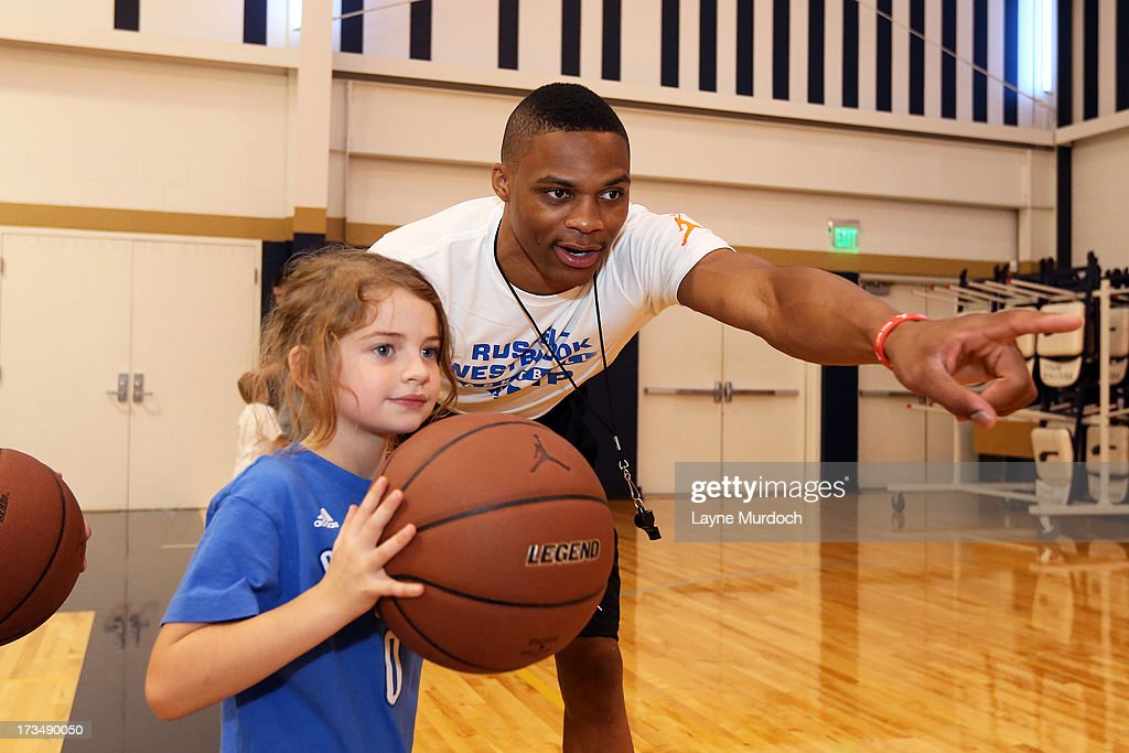 Oklahoma City Thunder Russell Westbrook coaches children at his basketball camp on July 10, 2013 at Heritage Hall in Oklahoma City, Oklahoma.