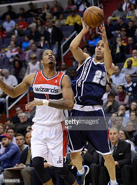 Oklahoma City Thunder shooting guard Kevin Martin puts up a shot against Washington Wizards small forward Trevor Ariza in the second quarter at the...