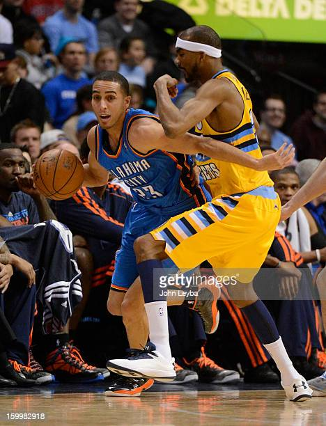 Oklahoma City Thunder shooting guard Kevin Martin works his way around the defense of Denver Nuggets small forward Corey Brewer during the second...