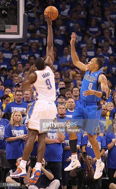 Oklahoma City Thunder's Serge Ibaka blocks a shot by Dallas Mavericks' Shawn Marion right in the first quarter in Game 3 of the NBA's Western...