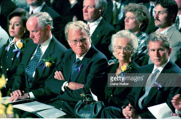Oklahoma Governor Frank Keating and wife Cathy sit with Billy Graham his wife Ruth and Texas Governor George Bush Jr at an April 23 1995 memorial...