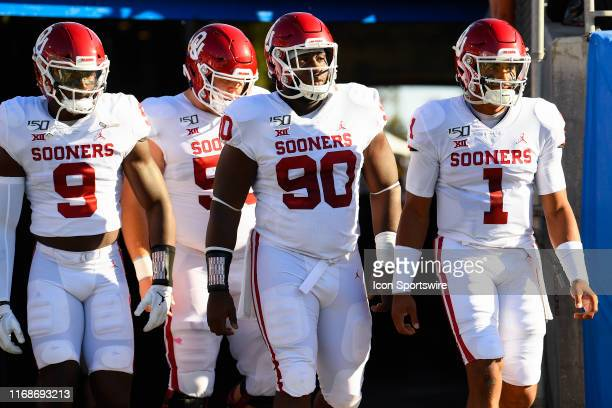 Oklahoma Kenneth Murray Oklahoma Creed Humphrey Oklahoma Neville Gallimore and Oklahoma Jalen Hurts walk out of the tunnel before the college...