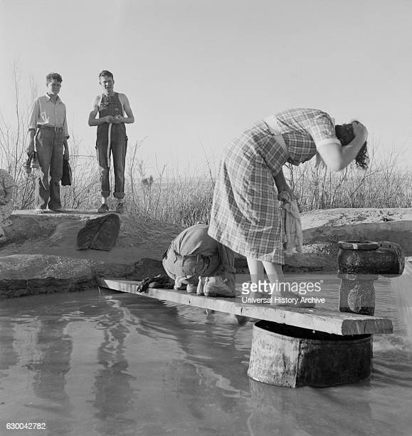 Oklahoma Migratory Workers Washing in Hot Spring in Desert, Imperial Valley, California, USA, Dorothea Lange for Farm Security Administration, March...
