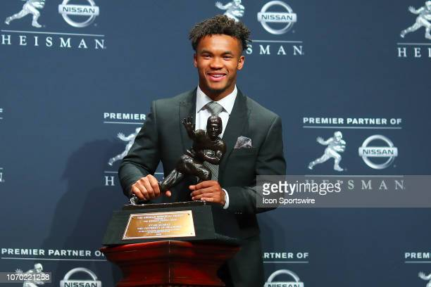 NEW Oklahoma quarterback Kyler Murray poses for photos after winning the 84th Heisman Trophy on December 8 2018 at the New York Marriott Marquis in...