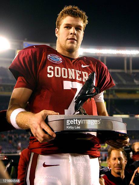Oklahoma quarterback Rhett Bomar holds the Holiday Bowl most valuable offensive player trophy after completing 17 of 30 passes for 229 yards and a...