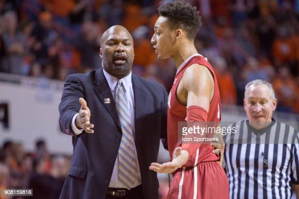 Oklahoma Sooners center Jamuni McNeace talks to a coach during the college Big 12 conference mens basketball game between the Oklahoma Sooners and...