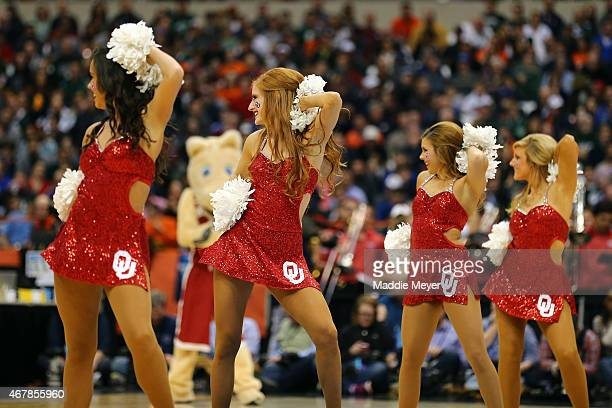 Oklahoma Sooners cheerleaders perform during a break in play against the Michigan State Spartans during the East Regional Semifinal of the 2015 NCAA...