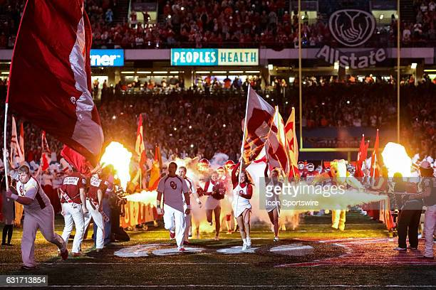 Oklahoma Sooners cheerleaders run out the tunnel before the game between the Auburn Tigers and the Oklahoma Sooners on January 02 2017 at the...