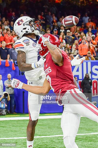 Oklahoma Sooners cornerback Jordan Thomas breaks up a pass intended for Auburn Tigers wide receiver Tony Stevens during the Sugar Bowl game between...