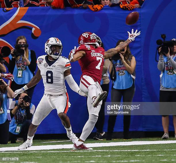 Oklahoma Sooners cornerback Jordan Thomas intercepts the ball intended for Auburn Tigers wide receiver Tony Stevens during the game between the...