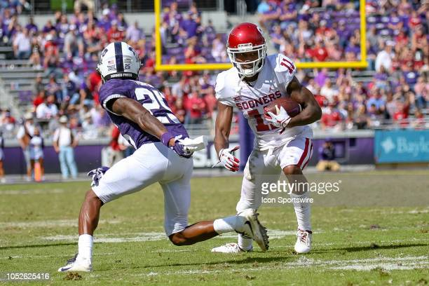 Oklahoma Sooners cornerback Parnell Motley intercepts a pass during the game between the Oklahoma Sooners and TCU Horned Frogs on October 20 2018 at...