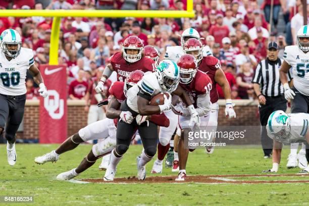 Oklahoma Sooners defensive back Steven Parker and Oklahoma Sooners linebacker Kenneth Murray tackle Tulane Green Wave running back Darius Bradwell...