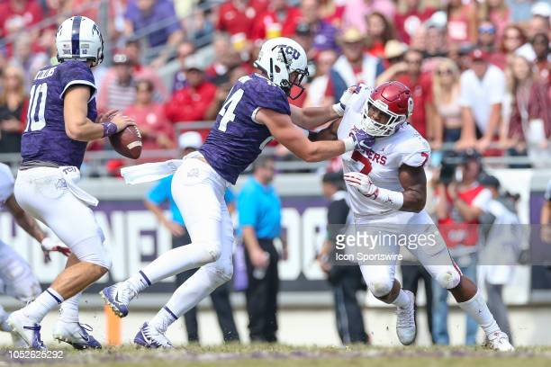 Oklahoma Sooners defensive end Ronnie Perkins works against TCU Horned Frogs tight end Cole Novak during the game between the Oklahoma Sooners and...