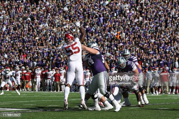 Oklahoma Sooners defensive lineman Kenneth Mann leaps to try and deflect a pass in the third quarter of a Big 12 football game between the Oklahoma...