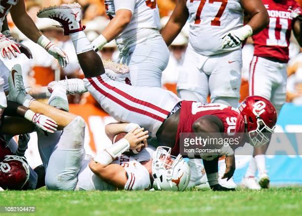 Oklahoma Sooners defensive lineman Neville Gallimore tackles Texas Longhorns quarterback Sam Ehlinger during the Red River Showdown between the...