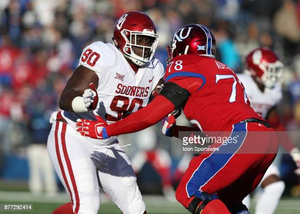 Oklahoma Sooners defensive tackle Neville Gallimore rushes against Kansas Jayhawks offensive lineman Hakeem Adeniji in the first quarter of a Big 12...