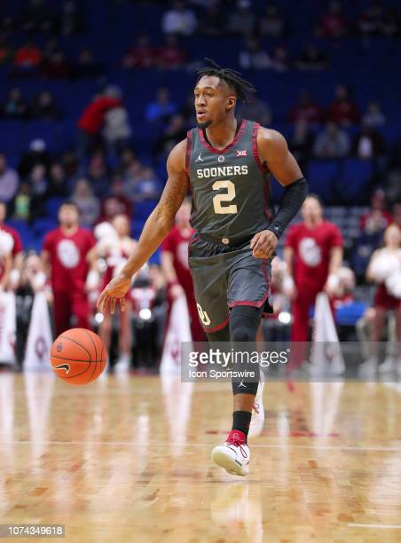 Oklahoma Sooners Guard Aaron Calixte advances the ball during a college basketball game between the Oklahoma Sooners and the Southern California...