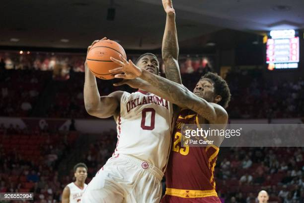 Oklahoma Sooners guard Christian James shoots over Iowa State Cyclones forward Zoran Talley Jr #23 during the second half of a NCAA college...